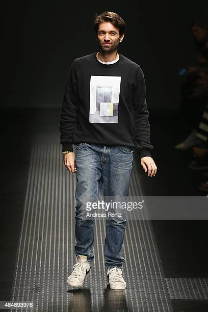 Designers Massimo Giorgetti acknowledges the applause of the audience after the MSGM show during the Milan Fashion Week Autumn/Winter 2015 on March...