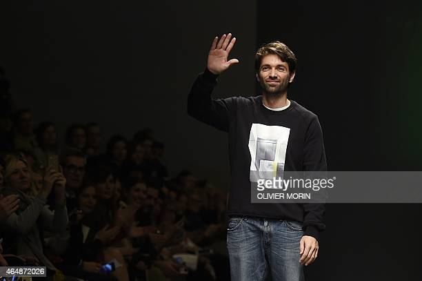 Designers Massimo Giorgetti greets the audience at the end of the show for fashion house MSGM at the women Fall / Winter 2015/16 Milan's Fashion Week...