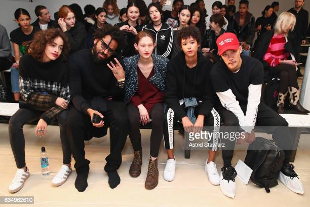 Designers Maxwell Osborne and DaoYi Chow with model and Dilone backstage for the Public School collection during New York Fashion Week The Shows at...