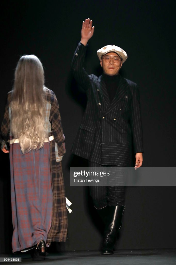 Designers Miao Ran acknowledges the applause of the audience at the Miaoran show during Milan Men's Fashion Week Fall/Winter 2018/19 on January 13, 2018 in Milan, Italy.