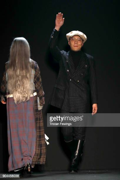 Designers Miao Ran acknowledges the applause of the audience at the Miaoran show during Milan Men's Fashion Week Fall/Winter 2018/19 on January 13...