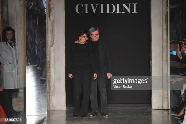 Designers Miriam Cividini and Piero Cividini acknowledge the applause of the public after the Cividini show at Milan Fashion Week Autumn/Winter...