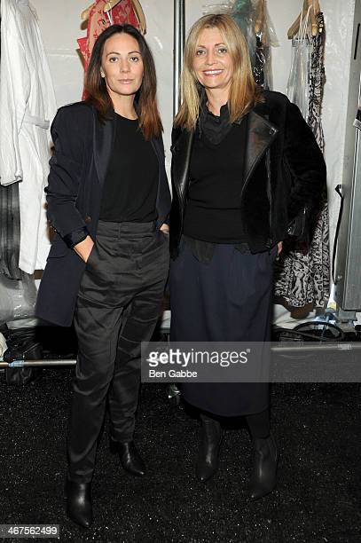 Designers Nicky Zimmerman and Simone Zimmerman pose backstage at Zimmermann fashion show during MercedesBenz Fashion Week Fall 2014 at The Pavilion...