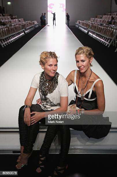 Designers of sass Bide Sarah Jane Clarke and Heidi Middleton pose backstage prior to the SB Vie By Sass Bide show on the fourth day of Rosemount...
