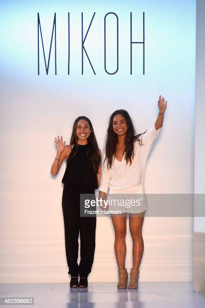 Designers Oleema Miller and Kalani Miller walk the runway at the Mikoh fashion show during MercedesBenz Fashion Week Swim 2015 at Oasis at The...