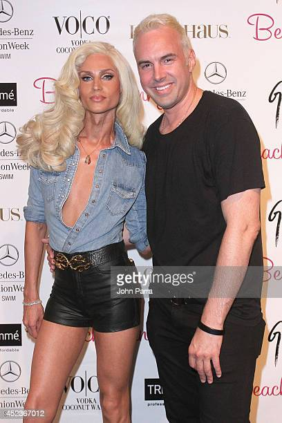 Designers Phillipe Blond and David Blond pose backstage at the Beach Bunny Featuring The Blonds show during MercedesBenz Fashion Week Swim 2015 at...