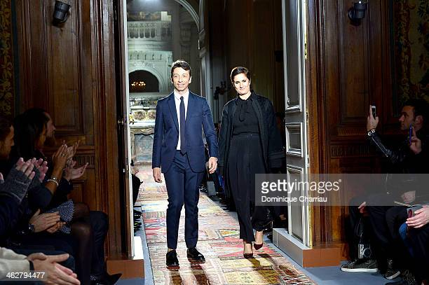 Designers Pier Paolo Piccioli and Maria Grazia Chiuri acknowledge the applause of the audience at the end of the Valentino Menswear Fall/Winter...