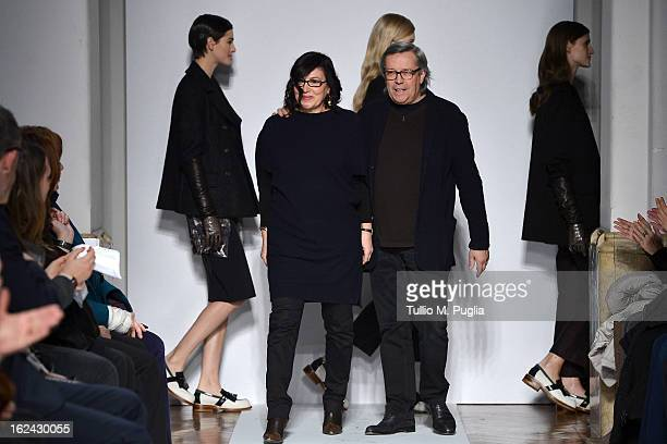 Designers Piero Cividini and Miriam Cividini acknowledge the applause of the audience as they walk the runway at the Cividini fashion show as part of...