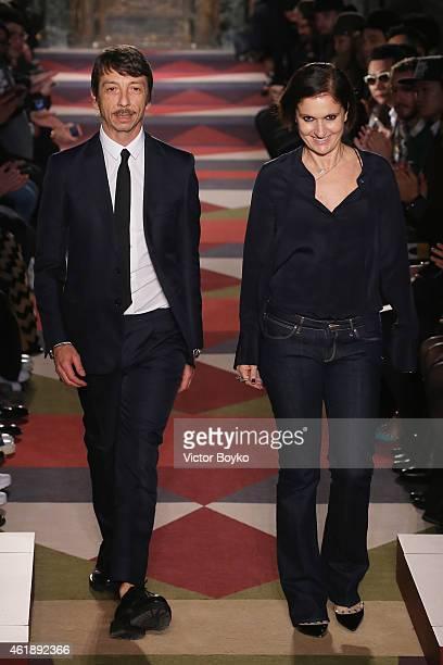 Designers Pierpaolo Piccioli and Maria Grazia Chiuri salute the public after the Valentino Menswear Fall/Winter 20152016 show as part of Paris...