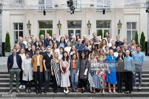 Designers pose ahead of the Group Presentation during 'Der Berliner Mode Salon' Spring/Summer 2018 at Kronprinzenpalais on July 7 2017 in Berlin...