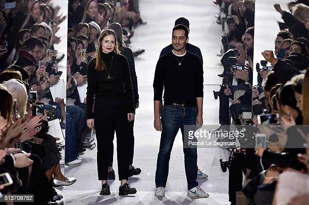 Designers pose the runway during the Christian Dior show as part of the Paris Fashion Week Womenswear Fall/Winter 2016/2017 on March 4 2016 in Paris...