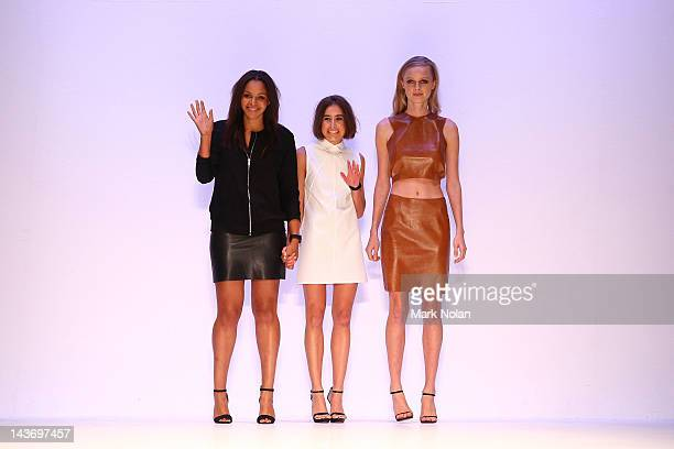 Designers Rachelle Sinclair and Fay Ogunbadejo with a model during the finale of Kahlo on the catwalk during the New Generation 1 group show on day...
