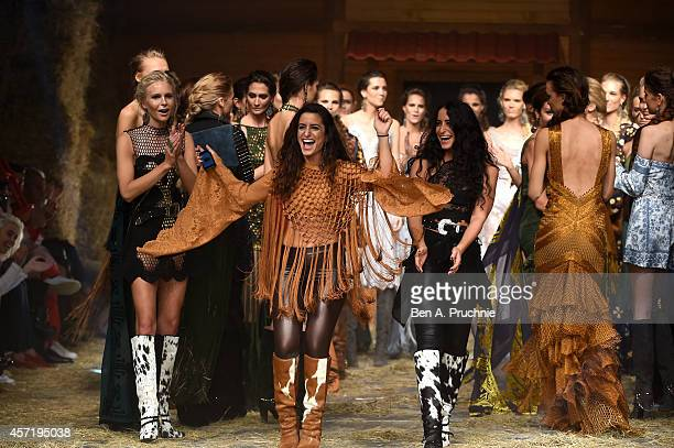 Designers Raisa and Vanessa Sason appear on the runway with models afte the Raisa Vanessa Sason show during Mercedes Benz Fashion Week Istanbul SS15...