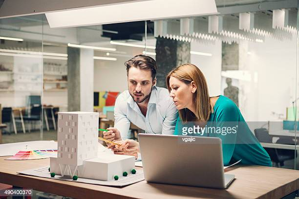 designers reviewing architectural model in the office. - architect stockfoto's en -beelden