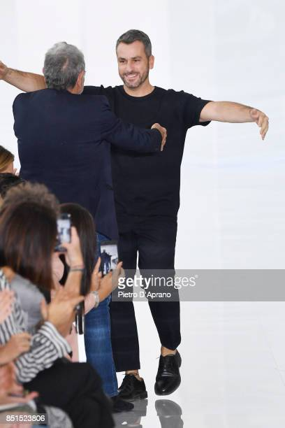 Designers Roberto Cavalli and Paul Surridge acknowledge the applause of the audience at the Roberto Cavalli show during Milan Fashion Week...