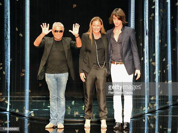 Designers Roberto Cavalli his wife Eva Cavalli and son Daniele Cavalli acknowledge the audience at the end of the Roberto Cavalli Collection show as...