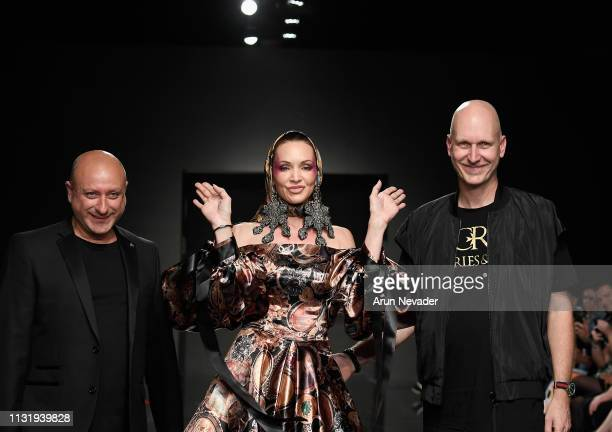 Designers Ron van Maarschalkerweed and Charles Borg walk the runway with model Patricia Hartmann at Los Angeles Fashion Week FW/19 Powered by Art...