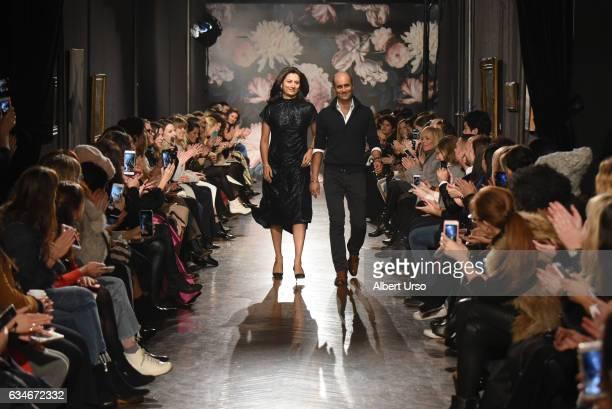 Designers Sachin and Babi Ahluwalia walks the runway at the Sachin & Babi fashion show during New York Fashion Week at The National Arts Club on...