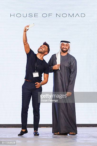 Designers Saleh Al Banna and Ahmed El Sayed pose at the runway at the House of Nomad show during Dubai collections March 2016 by Emaar at Burj...