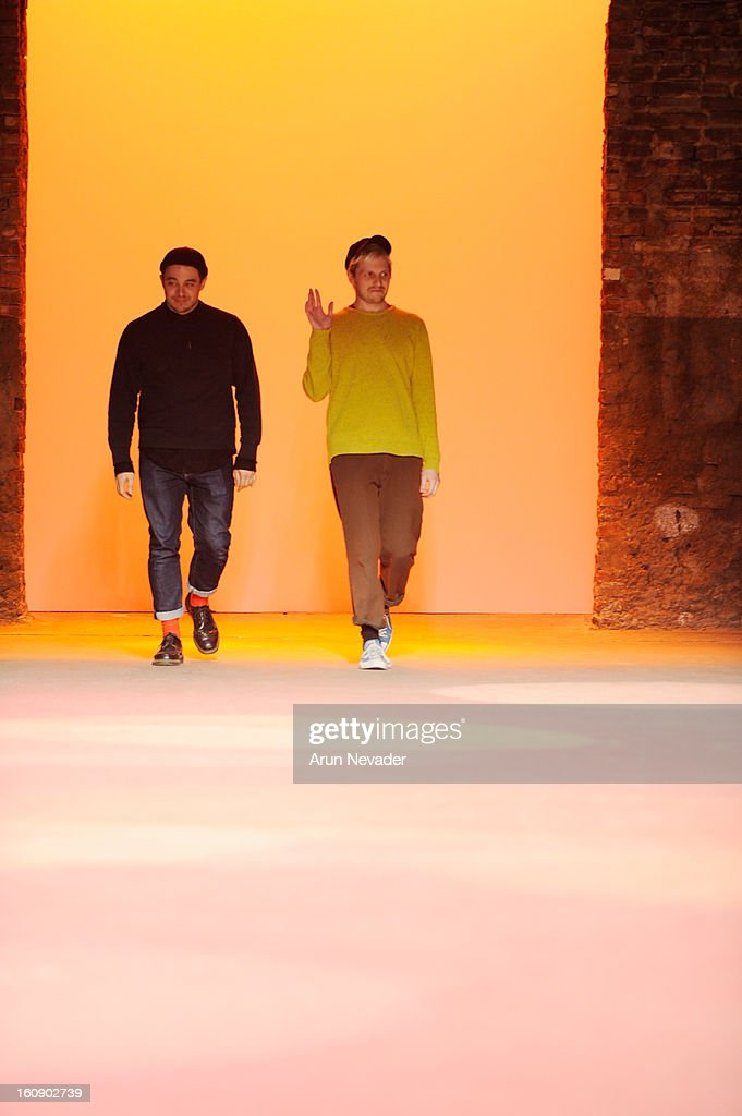 Designers Shane Gabier (L) and Christopher Peters appear on the runway at the Creatures of the Wind: New York Fashion Week Fall/Winter 2013 at Eyebeam Gallery on February 7, 2013 in New York City.