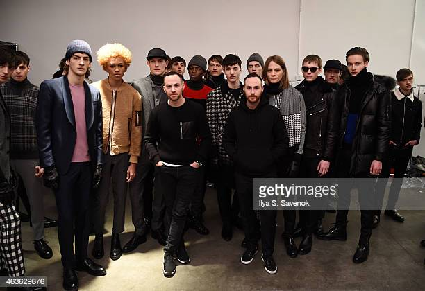 Designers Shimon Ovadia and Ariel Ovadia pose with models backstage at the Ovadia Sons fashion show during MercedesBenz Fashion Week Fall 2015 at...