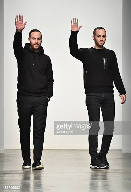 Designers Shimon Ovadia and Ariel Ovadia walk the runway at the Ovadia Sons runway show during MercedesBenz Fashion Week Fall 2015 at Pier 59 on...
