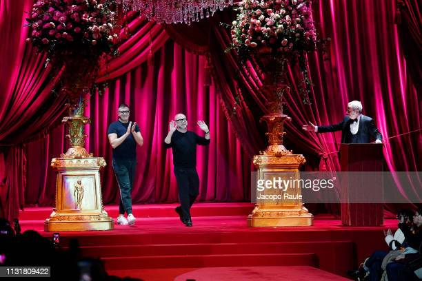 Designers Stefano Gabbana and Domenico Dolce acknowledge the applause of the audience at the Dolce & Gabbana show at Milan Fashion Week Autumn/Winter...
