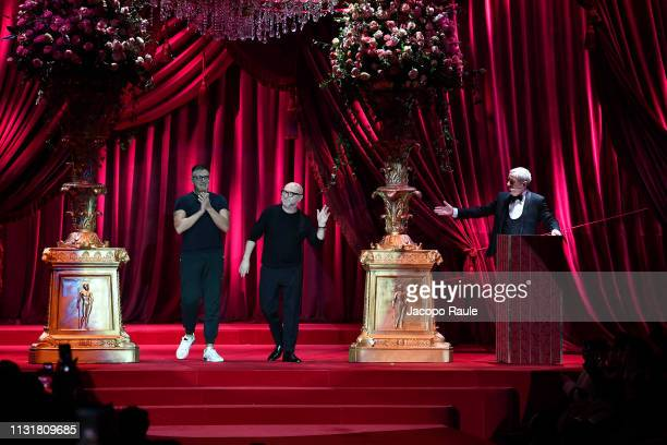 Designers Stefano Gabbana and Domenico Dolce acknowledge the applause of the audience at the Dolce Gabbana show at Milan Fashion Week Autumn/Winter...
