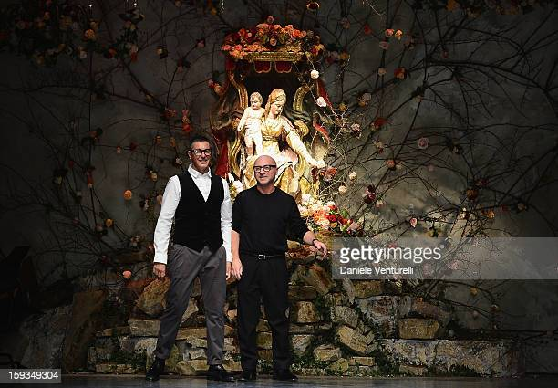 Designers Stefano Gabbana and Domenico Dolce acknowledge the applause of the audience after the Dolce Gabbana show as part of Milan Fashion Week...