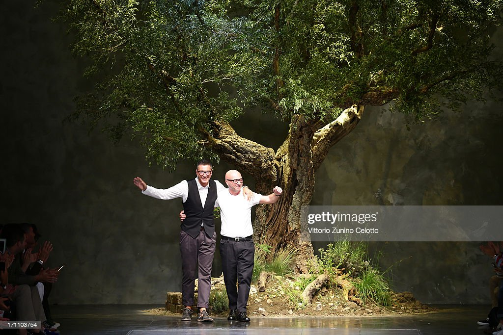 Designers Stefano Gabbana (L) and Domenico Dolce acknowledge the applause of the audience after the Dolce & Gabbana show during Milan Menswear Fashion Week Spring Summer 2014 on June 22, 2013 in Milan, Italy.