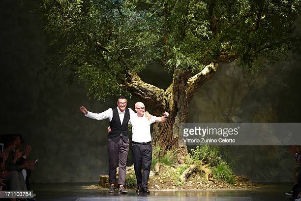 Designers Stefano Gabbana and Domenico Dolce acknowledge the applause of the audience after the Dolce Gabbana show during Milan Menswear Fashion Week...
