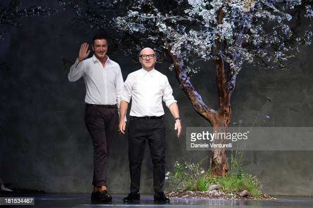 Designers Stefano Gabbana and Domenico Dolce acknowledge the applause of the public after the Dolce Gabbana show as a part of Milan Fashion Week...