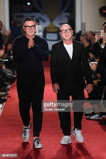 Designers Stefano Gabbana and Domenico Dolce acknowledge the applause of the audience at the Dolce Gabbana Unexpected Show during Milan Men's Fashion...