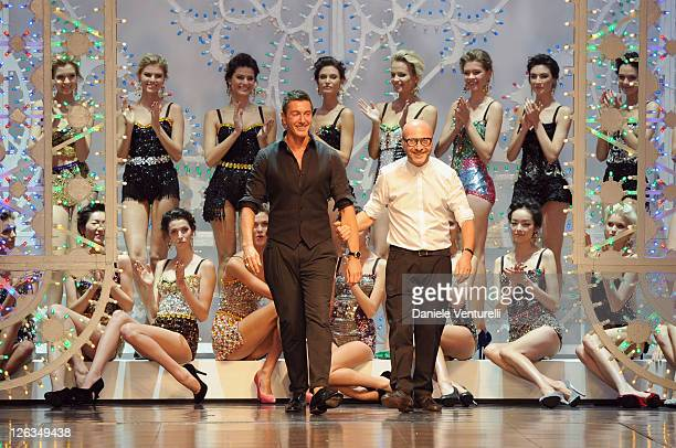 Designers Stefano Gabbana and Domenico Dolce aknowledges the applause of the public after the Dolce Gabbana Spring/Summer 2012 fashion show as part...