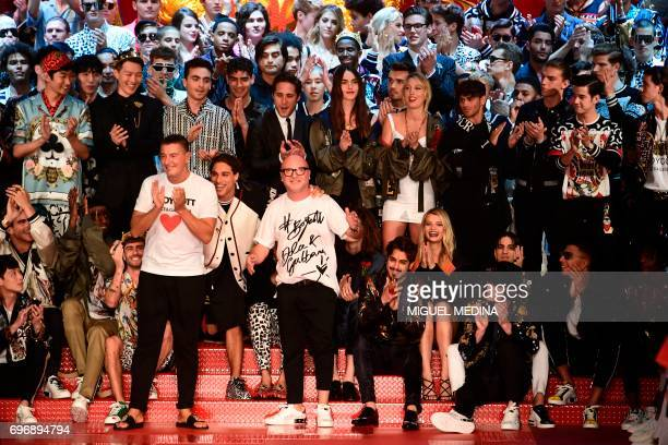 Designers Stefano Gabbana and Domenico Dolce greet the audience at the end of their show forfashion house Dolce Gabbana during the Men's...
