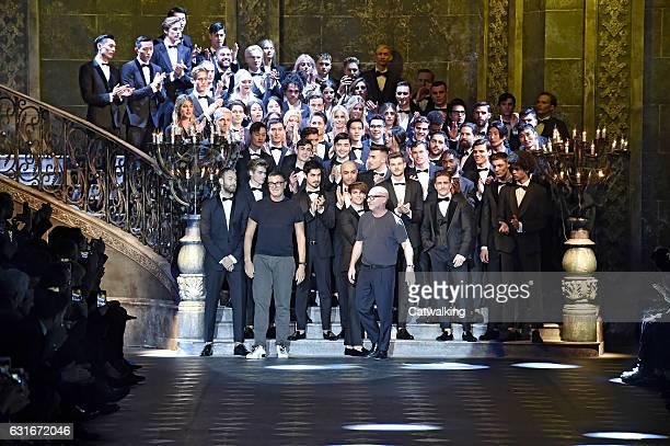 Designers Stefano Gabbana and Domenico Dolce walk the runway finale at the Dolce Gabbana Autumn Winter 2017 fashion show during Milan Menswear...