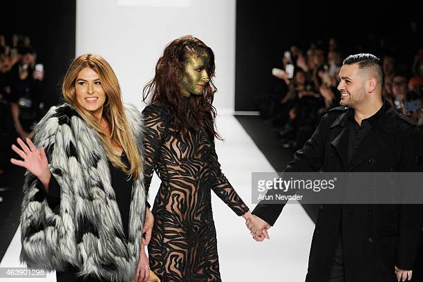 Designers Stephanie Costello a model and Michael Costello walk the runway at the Art Hearts Fashion Show Presented By AIDS Healthcare Foundation...