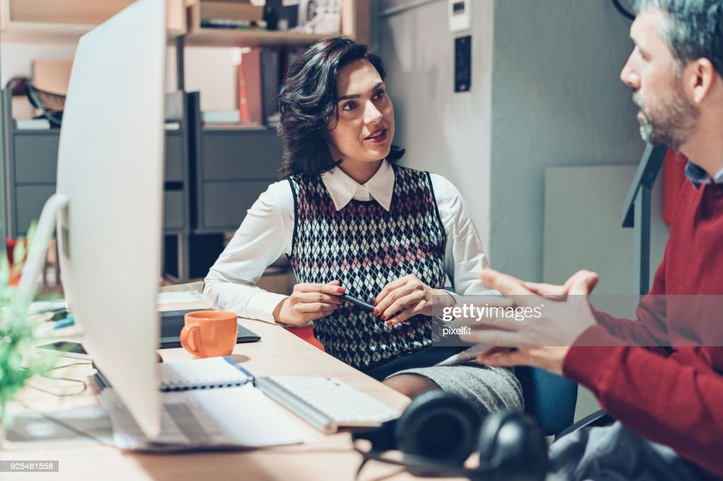 Designers talking in the office : Stock Photo