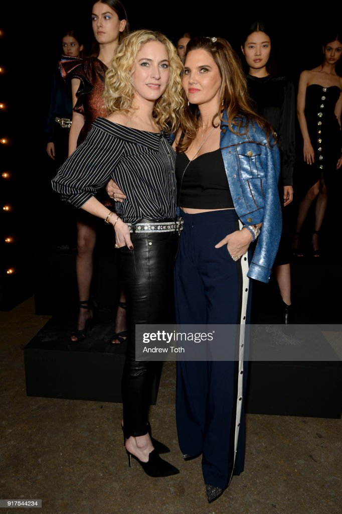 Designers Veronica Swanson Beard and Veronica Miele Beard pose with models at the runway for the Veronica Beard Fall 2018 presentation at Highline Stages on February 12, 2018 in New York City.