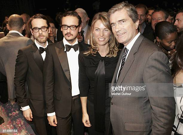 Designers Victor Rolf pose with Loreal's President Gilles Weil and his wife at the Victor Rolf fashion show as part of Paris Fashion Week...