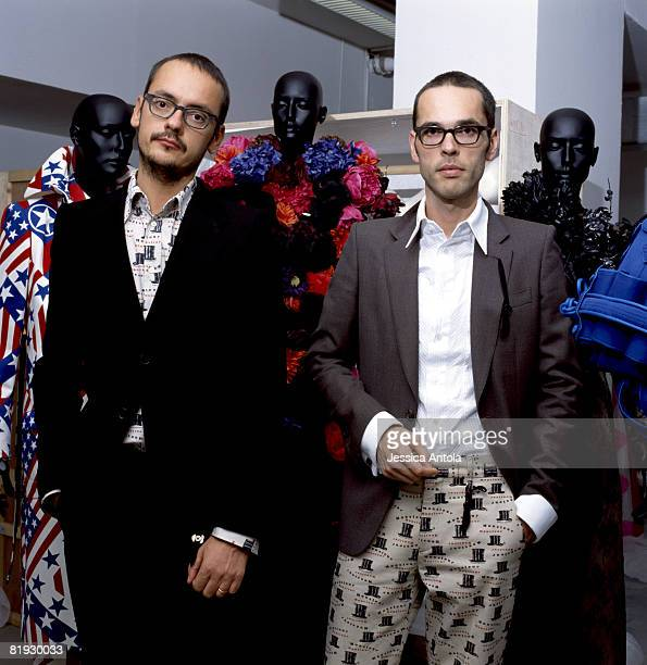 Designers Viktor and Rolf are photographed in the Louvre.