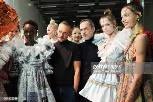 Designers Viktor Horsting and Rolf Snoeren pose backstage before the Viktor & Rolf Haute Couture Spring/Summer 2020 show as part of Paris Fashion...