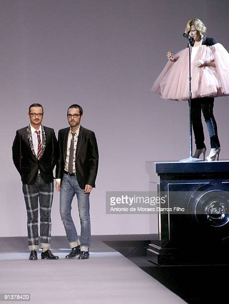 Designers Viktor Horsting and Rolf Snoeren walk the runway at Viktor Rolf Pret a Porter show during Paris Womenswear Fashion Week Spring/Summer 2010...