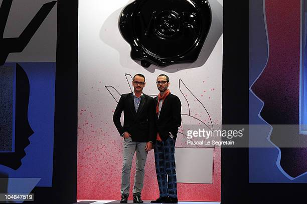 Designers Viktor Horsting and Rolf Snoeren walk the runway during the Viktor Rolf Ready to Wear Spring/Summer 2011 show during Paris Fashion Week at...