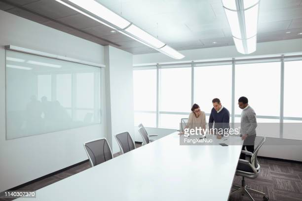 designers working on layouts in conference room - initiative stock pictures, royalty-free photos & images