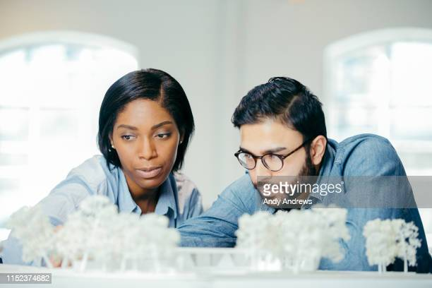 Designers working with an architectural model