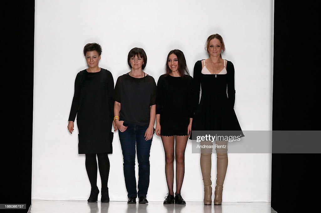 Designers Zalina Verkhovskaya, Irina Gaynullina, Vera Kuzmichevaa and Ekaterina Mikhaylova appear on the runway at the end of the Best Collections of BHSAD 'Fashion Design' Course show during Mercedes-Benz Fashion Week Russia S/S 2014 on October 28, 2013 in Moscow, Russia.