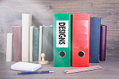http://www.istockphoto.com/photo/designs-binder-on-desk-in-the-office-business-background-gm831797018-135321001