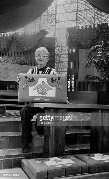 DEC 12 1977 DEC 29 1977 DEC 30 1977 Designs In Needlepoint Mary Jo of Littleton United Methodist Church holds up one of 30 kneelers done in...