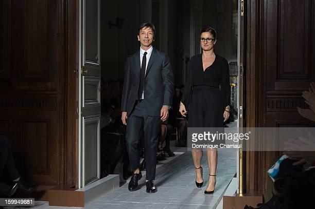 Desiners Pier Piccioli and Maria Grazia Chiuri walk the runway after the Valentino Spring/Summer 2013 HauteCouture show as part of Paris Fashion Week...